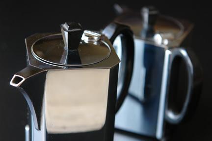 chrome Art Deco tea set with black bakelite handles & knobs comprises tea pot, hot water pot, milk jug and sugar bowl